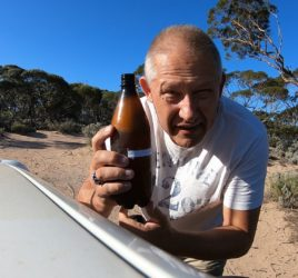 Vic opening his Coopers Craft Pale Ale on the Nullarbor