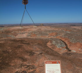 Trig point and gnammas on Mount Wudinna, South Australia