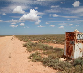 Rusty box road marker on Cook Road, 95Km to Eyre Highway