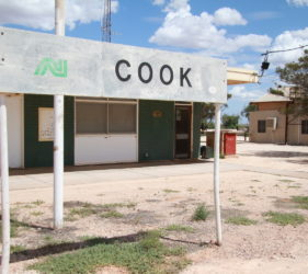 Station masters office in front of Cook Railway Sign