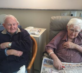Leonie's Dad (left) and his brother Jack tackling a word puzzle in Gumeracha Hospital